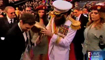 Sacha Baron Cohen -- Spills Ashes All Over Ryan Seacrest at the Oscars