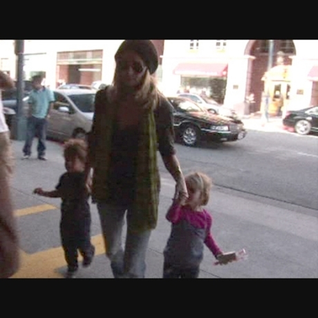Heidi and the little ones get swarmed by paps.