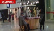 Joe Jackson Hocks Perfume In Tacky Mall
