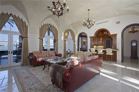The 8,881 square foot oceanfront palace -- located on the ultra-exclusive La Gorce Island -- boasts 7 bedrooms, 8.5 baths ... and happens to be surrounded by famous neighbors like <strong>Cher</strong> and <strong>Lil Wayne</strong>.