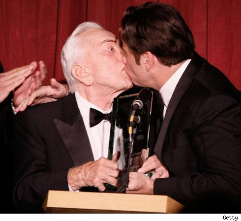 Travoltas hetero man on man kiss take 2 tmz award at the santa barbara film festival on thursday they did what any two average straight red blooded american men would do they locked lips m4hsunfo