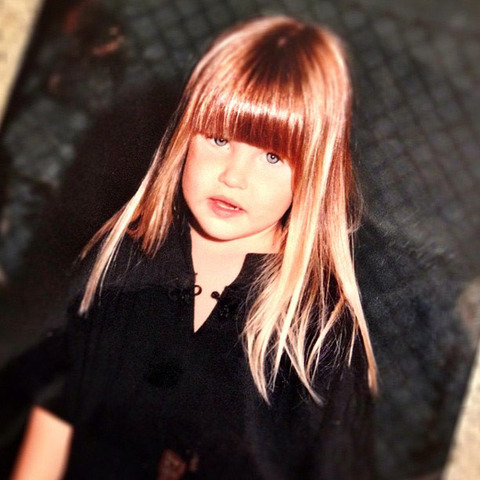 This banged brunette grew up to be one of Hollywood's most beautiful faces -- can you guess who she grew up to be?!