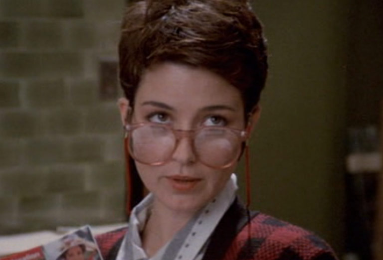 Annie Potts as the cynical secretary and love interest of Dr. Egon.