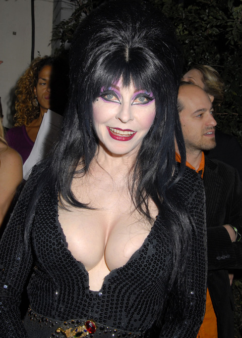 <p>The<span>Mistress of the Dark</span>must have made a deal with the undead because her photos are still making hearts pound 40 years later.</p> <p>It's frightening how hot she is!</p>