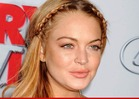 Lindsay Lohan Violates Rehab Deal -- Flying To California