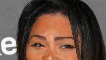 Lil' Kim Changes her Racial Makeup