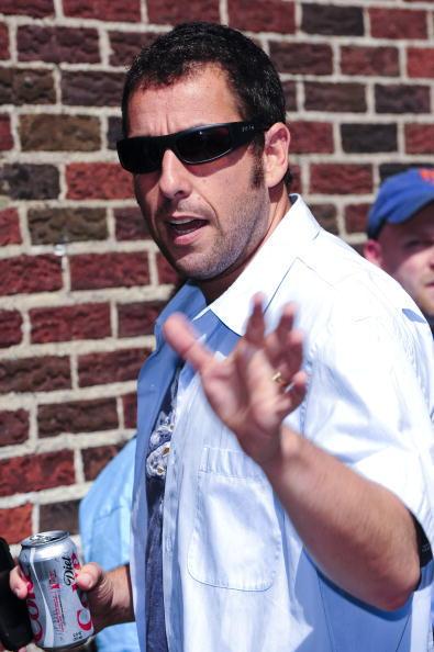 Adam Sandler presents his left hand in 2009.