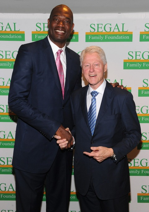 Dikembe Mutombo and Bill Clinton