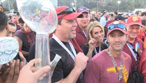 Cheryl Hines -- Faces Off with Giant Football Bong ... at BCS Championship