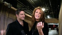 Angie Everhart -- Forget Love in an Elevator ... She Got Engaged in One!