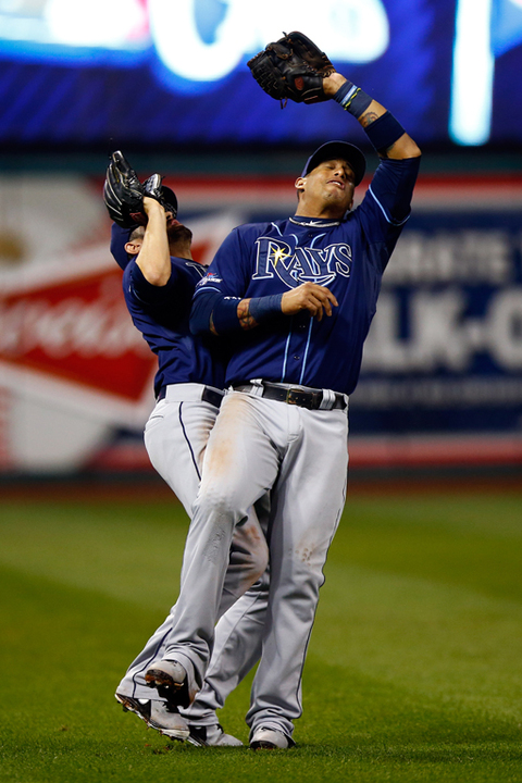 Yunel Escobar and David DeJesus of the Tampa Bay Rays collide after catching a fly ball