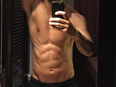 Guess Whose Sexy Stomach -- See the Coachella Hunk