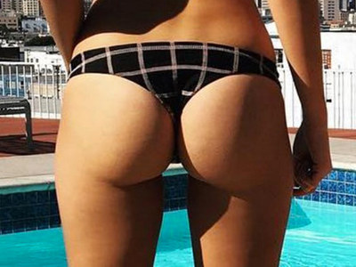 Guess Whose Bikini Bum -- See The Poolside Posterior