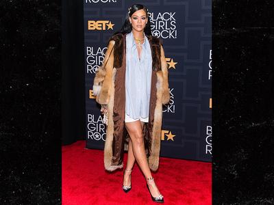 Rihanna -- Sunny With A Chance of Snow? Fur Coat & Shorts Combo (PHOTO)