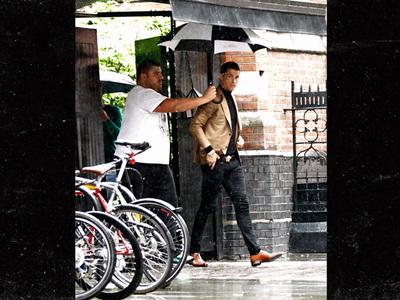 Cristiano Ronaldo -- I've Got My Own Umbrella Guy ... Seriously. (PHOTO)