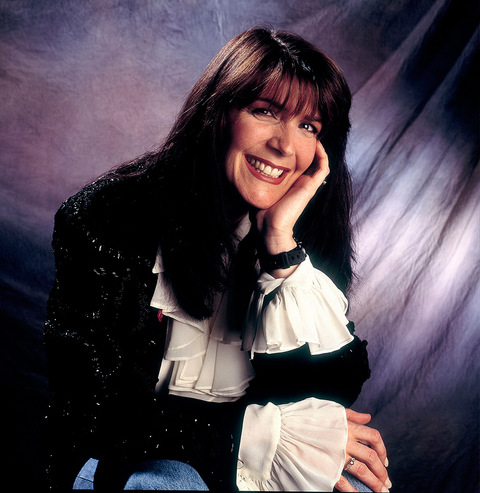 "Kathy Mattea shot to stardom in the late '80s when her songs like ""18 Wheels and a Dozen Roses"", ""Love at the Five and Dime"" and ""Goin' Gone"" topped the country billboard charts."