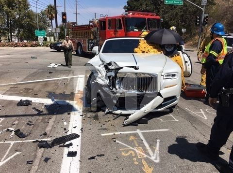 Kris Jenner was just involved in a car wreck off the 101 freeway near her home. According to law enforcement sources.  Kris' white Rolls-Royce collided with a Prius -- the force of the impact deployed her airbag and absolutely destroyed the front end.
