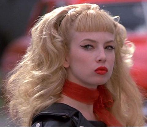"Traci Lords as ""Wanda Woodward"""