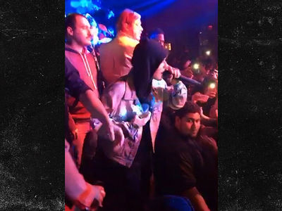 Justin Bieber Braves Bronchitis, Surprises Crowd with Mini Performance (VIDEO)
