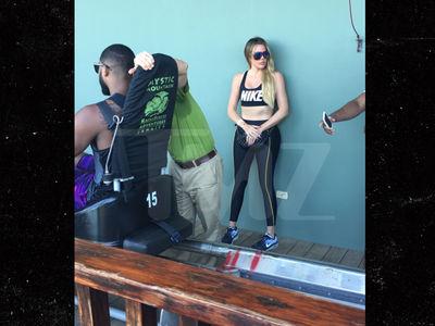 Khloe Kardashian Jumps on Tristan Thompson's Nike Train (PHOTOS)