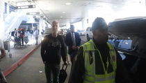 James Cameron Confronted by Traffic Cop at Airport (VIDEO)