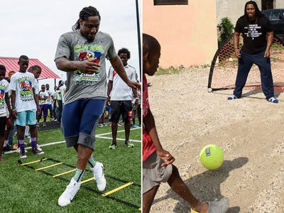 Marshawn Lynch Looks NFL Ready During Haiti Charity Trip (PHOTO GALLERY)