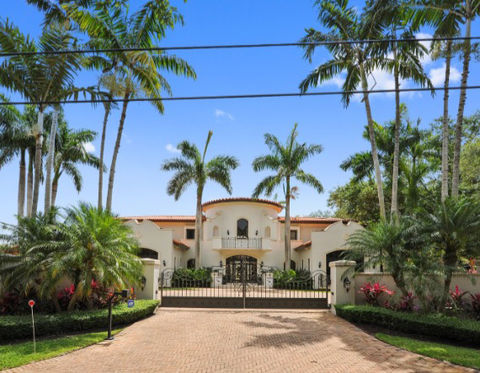 <span>The 6 bedroom, 7.5 bathroom compound sits inside an exclusive gated community, and it has all the bells and whistles -- from a grand foyer entrance and media room to a pool, spa, tennis court and, of course, a basketball court. </span>