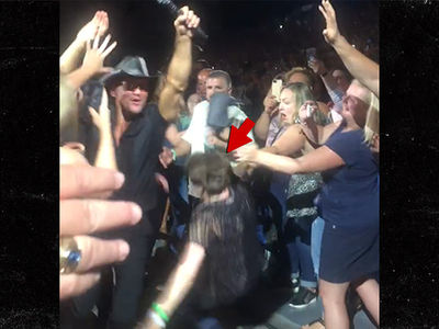 Tim McGraw Concert, Female Fan Falls Hard (VIDEO)