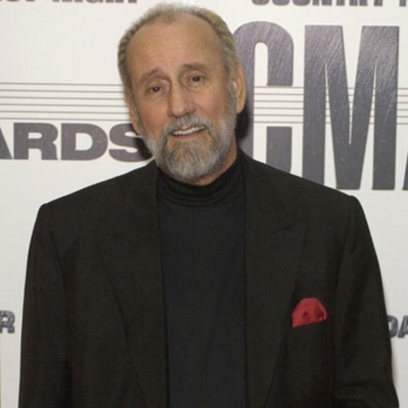 Ray Stevens was caught attending an awards ceremony.