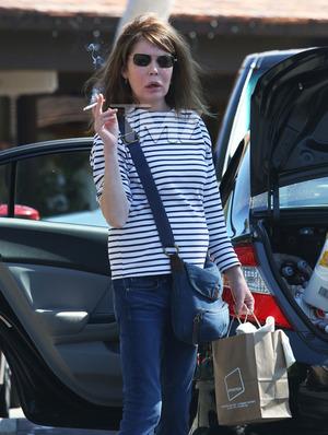 Lara Flynn Boyle -- Mystery Behind Shocking New Photographs
