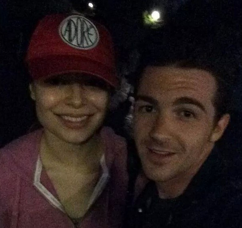 July 22nd, 2014 -- Chilling with Miranda Cosgrove at the Happiest Place on Earth.