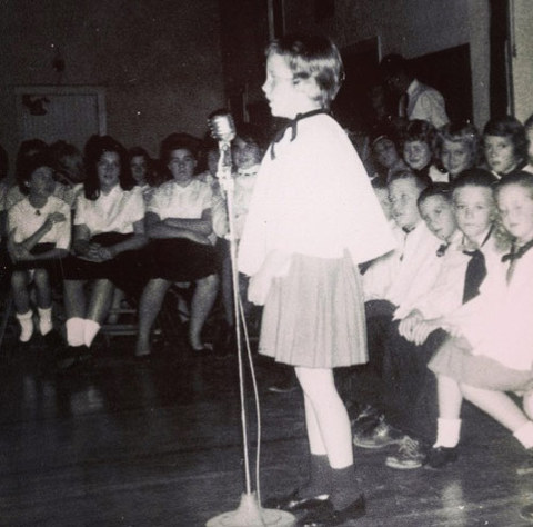 Before this brave little girl was singing shows around the world she was just another cute little girl singing to her first grade class in McAlester, Oklahoma.