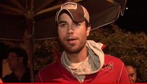 Enrique Iglesias -- Arrested for Driver's Seat Switcheroo