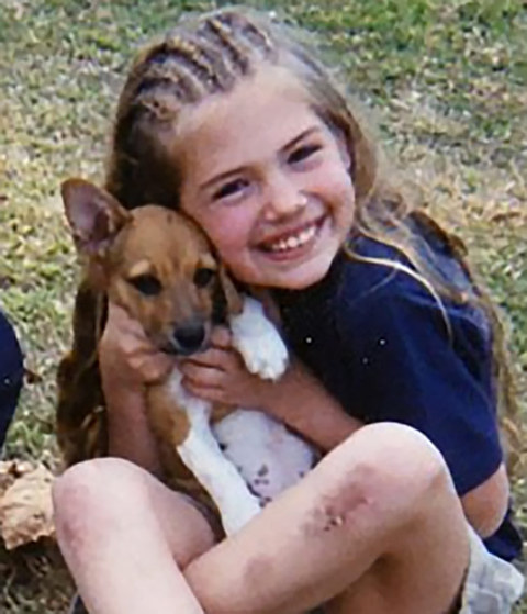 Before this canine cuddler was making men's tails wag as an international model she was just another sweet little girl posing with a puppy in Melbourne, Florida.