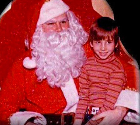 Before this nice little boy became a naughty goth god he was just another mini man in a turtleneck posing with Santa in Canton, Ohio.