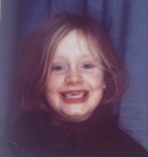 Rumor has it that before this toothless tot was singing her heart out for sold-out crowds, she was just another grinning gal in London, England