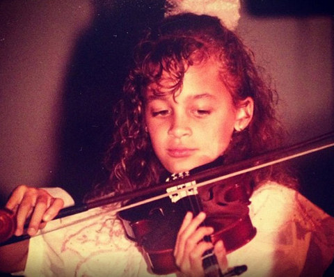 Before this curly haired cutie was living the good life as a Hollywood star, she was just another bow-bearing musician living the simple life in Berkeley, California.