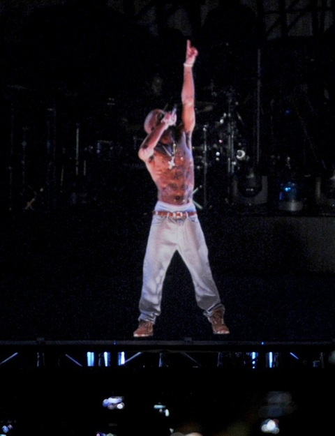 2012:  A holographic image of Tupac Shakur is seen performing during day 3