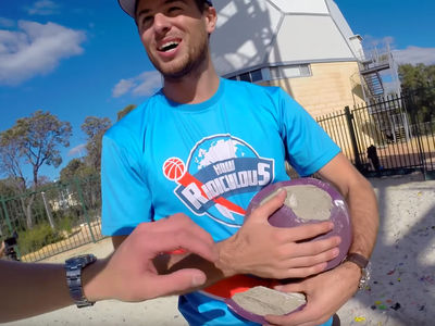 Battle Axe Versus Bowling Ball -- No One Is Spared! (VIDEO)