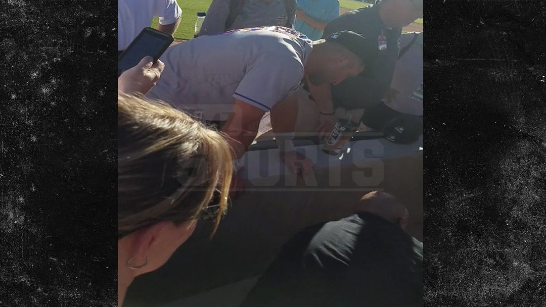 Tim Tebow Prays Over Collapsed Fan After Seizure At Fall
