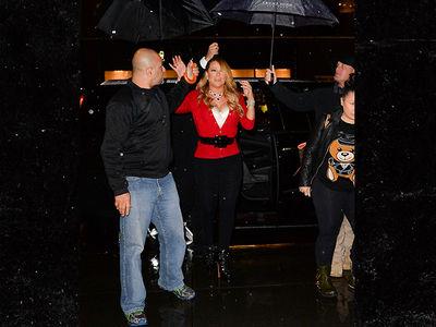 Mariah Carey -- I Don't Do Rain! Send in My Umbrella Team (PHOTOS)