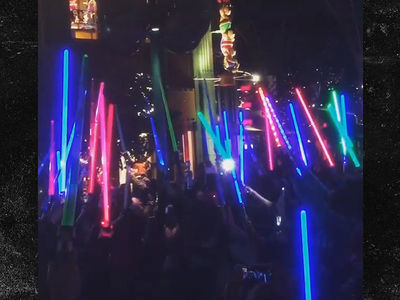 Carrie Fisher Gets a Lightsaber Tribute at Downtown Disney (VIDEO)