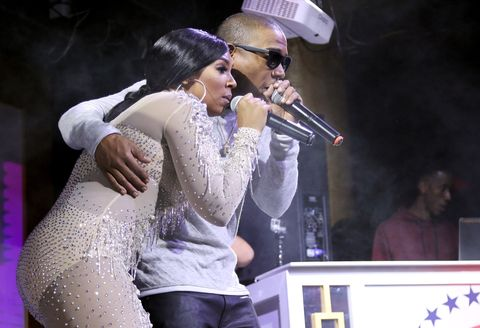 Singers Ashanti and Ja Rule perform onstage at The Barstool Party