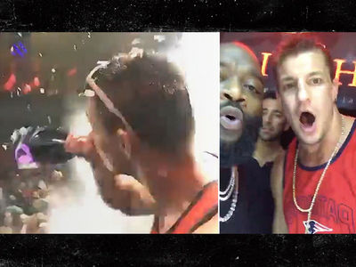 Gronk Chuggin' Champagne with Rick Ross ... At Another Super Bowl Rager (VIDEO)