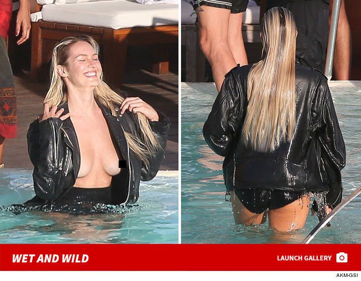 Candice Swanepoel doesn't seem to know -- or care -- what water does to  leather ... she swam with some of it on and nothing underneath.