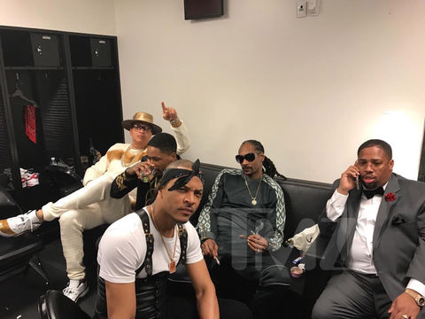 Snoop Dogg, T.I., YG, and crew relax back stage.
