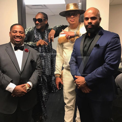 Snoop Dogg and crew pose backstage at the 32nd Annual Rock & Roll Hall Of Fame Induction Ceremony at Barclays Center.
