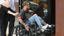 Zayn Malik Rolls Into Gigi Hadid's Apartment Building in a Wheelchair (PHOTO)