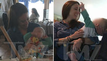 Casey Anthony Photographed with Baby in Her Arms (PHOTO GALLERY)