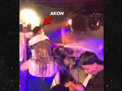 Akon Gets His Champagne Spray On in Monte Carlo Ahead of Moncaco Grand Prix (VIDEO)